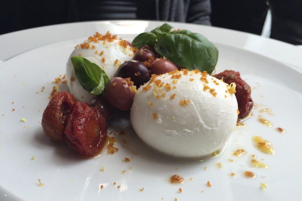 Buffalo mozzarella with candied cherry tomatoes and Gaeta olives at Brunello Lounge and Restaurant