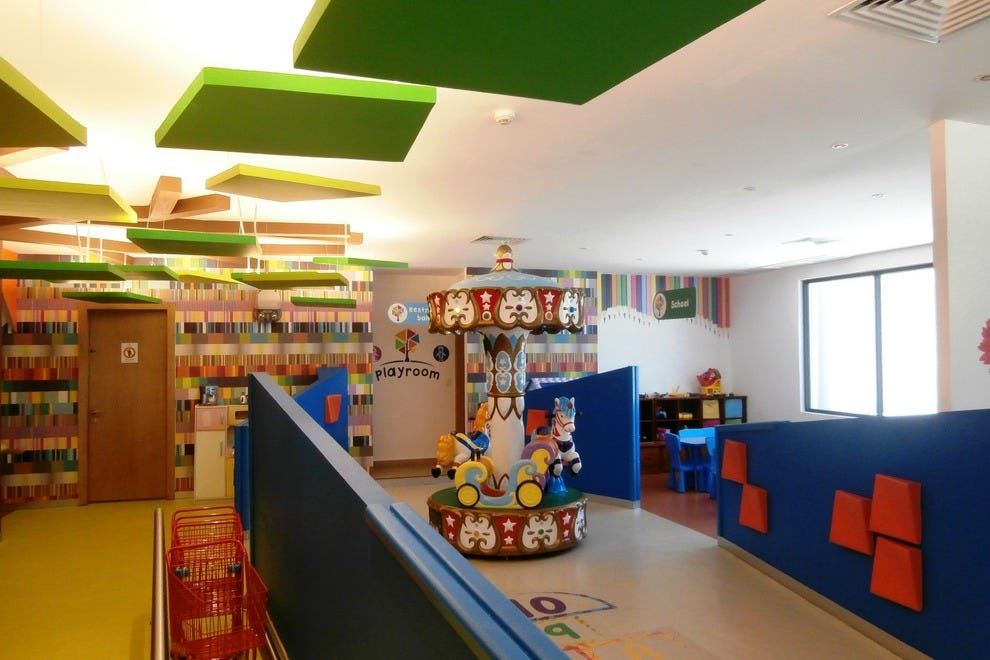 The Sunrise Playroom is very large, while the Nizuc Playroom is more compact