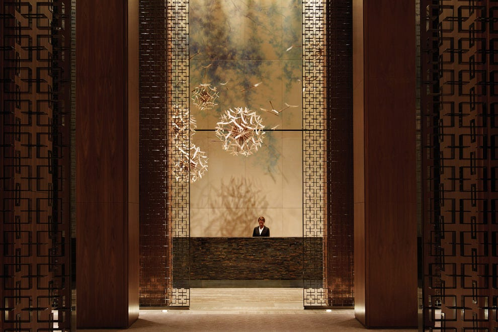Come into the opulent lobby and be prepared for everything to change (in a good way) at Four Seasons Toronto