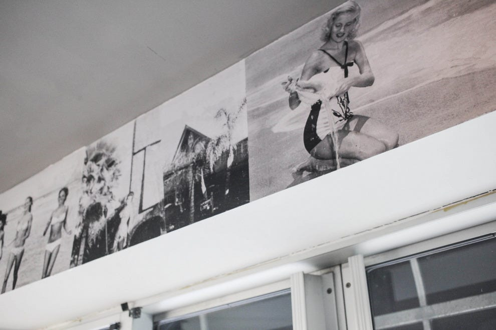 Flask & Cannon's walls are lined with retro images of bathing beauties and beach culture in bygone eras