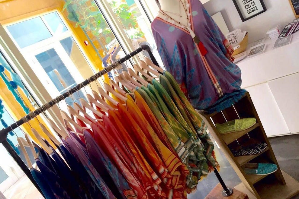 Brightly colored tops and inspirational signs are just some of the items you'll find at Metta Loving Kindness