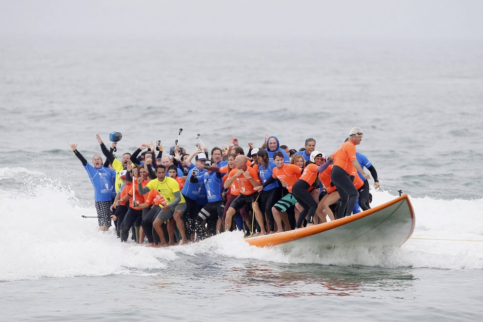 Sixty-six surfers set a new Guinness World Record on Saturday.