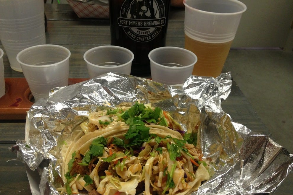 Duck tacos from the Nosh Truck plus a beer flight equals happiness at Fort Myers Brewing Company