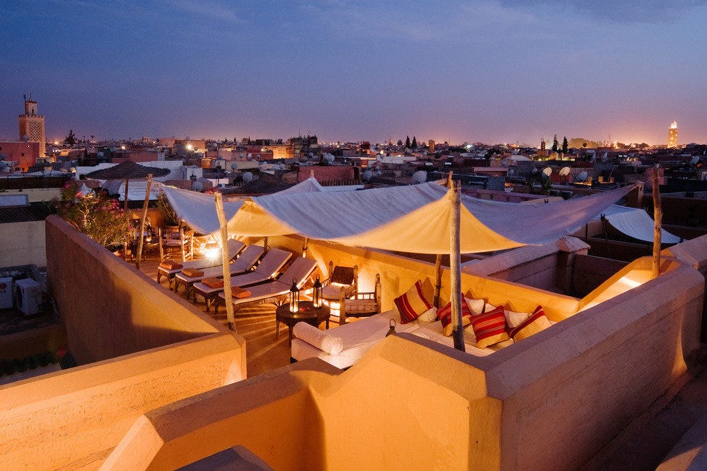 A balmy Mediterranean evening with cool drink in hand–life is good on the terrace of Dar Hanane in Marrakech.