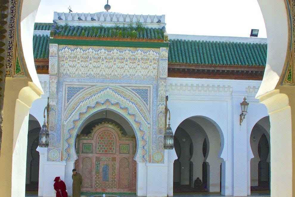 Graceful entryways resemble keyholes in architecture ancient and modern in Morocco.