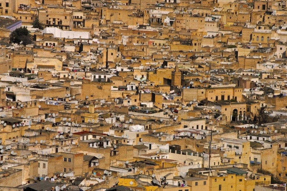 The medina in Fès is tightly packed with residences and souks (shops). Medinas are walled cities that kept enemies out in medieval times.