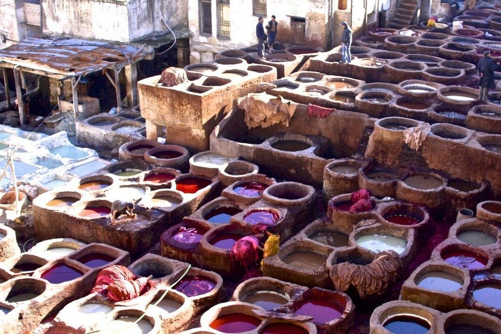 Colorful vats of vegetable dyes create a rainbow of purses and satchels in Fès tanneries that are open to visitors.