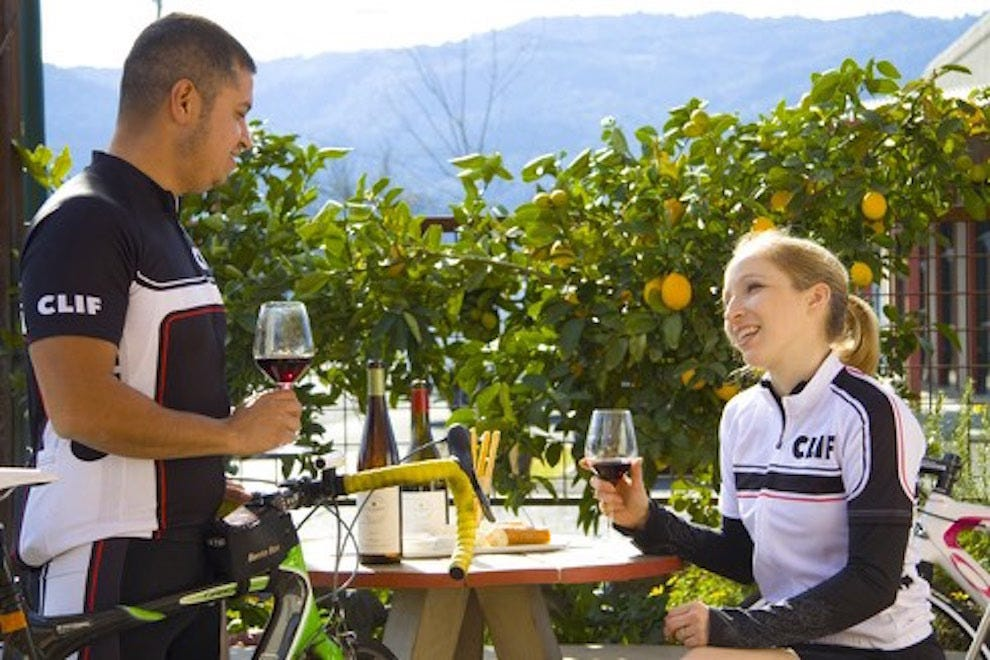 Cyclists enjoy wine on the patio of Clif Family Winery in St. Helena
