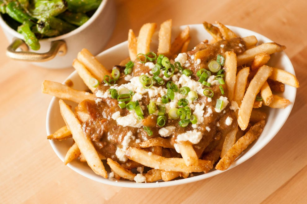 The Depot's menu includes creative pub food like poutine with oxtail gravy