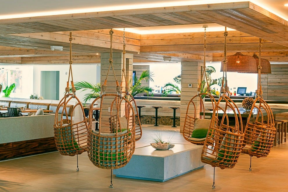 Swinging chairs in the lobby of Amara Cay Resort evoke the whimsy of vacation