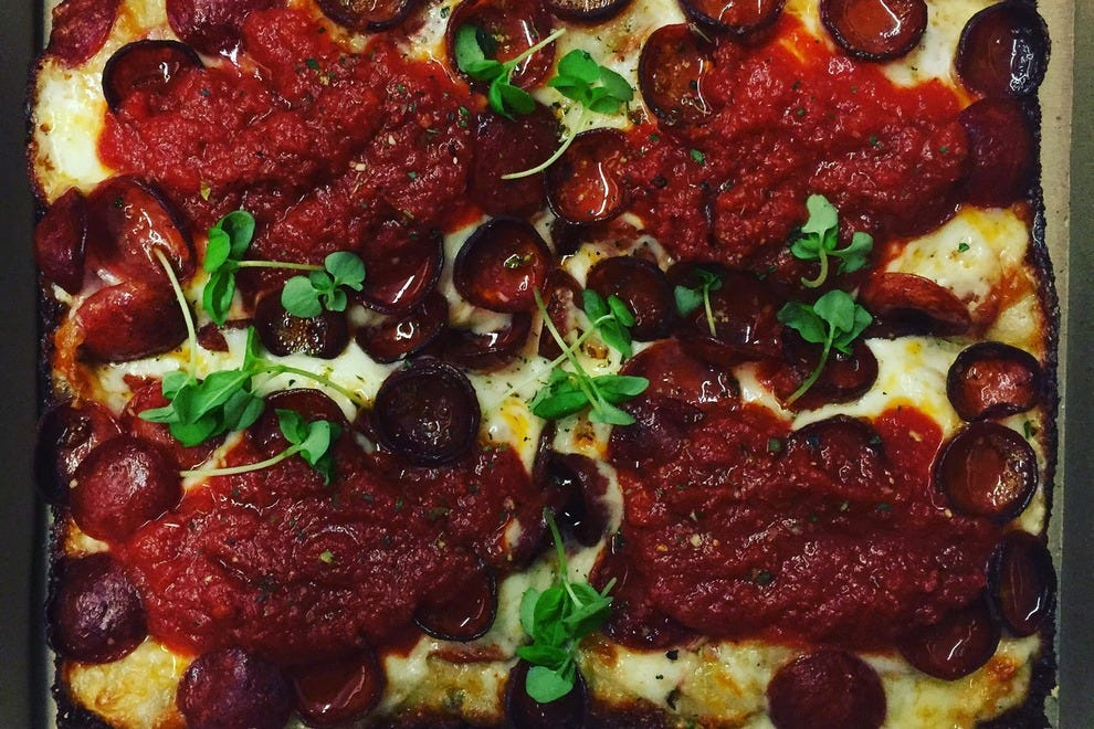 This pizza at Descendant comes with two types of pepperoni, micro basil, Sicilian oregano and tomato sauce