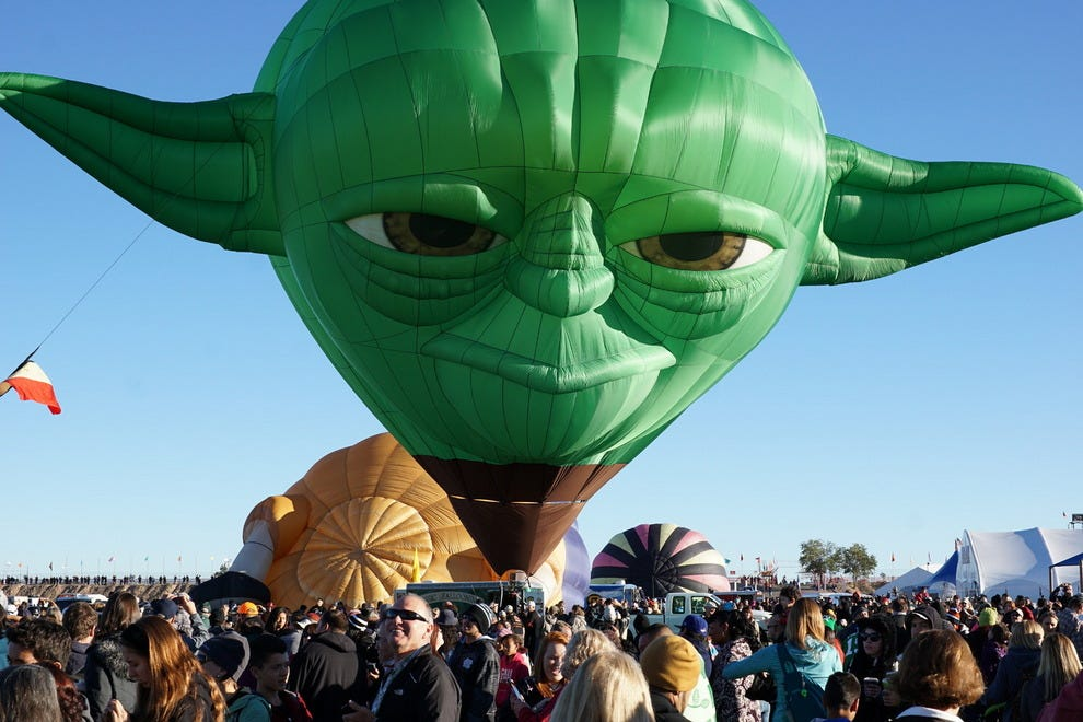 """Yoda from """"Star Wars"""" delights spectators at the 2014 Albuquerque International Balloon Fiesta. He, his friend Darth Vader and 548 other balloons – almost 100 of which are special shape balloons – return to Albuquerque the first week of October."""