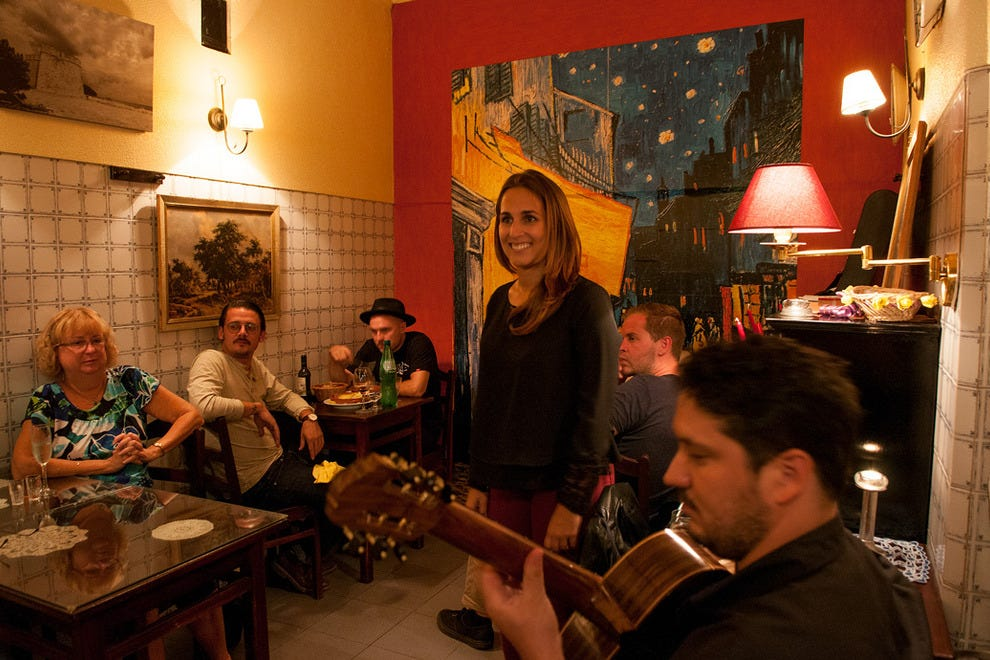 Fado singer Sofia Ramos and guitarist Bruno Fonseca regaling diners with voice and guitar