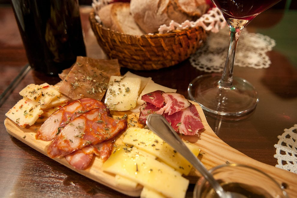 Appetizer options include hams and cheeses from Portugal's many regions
