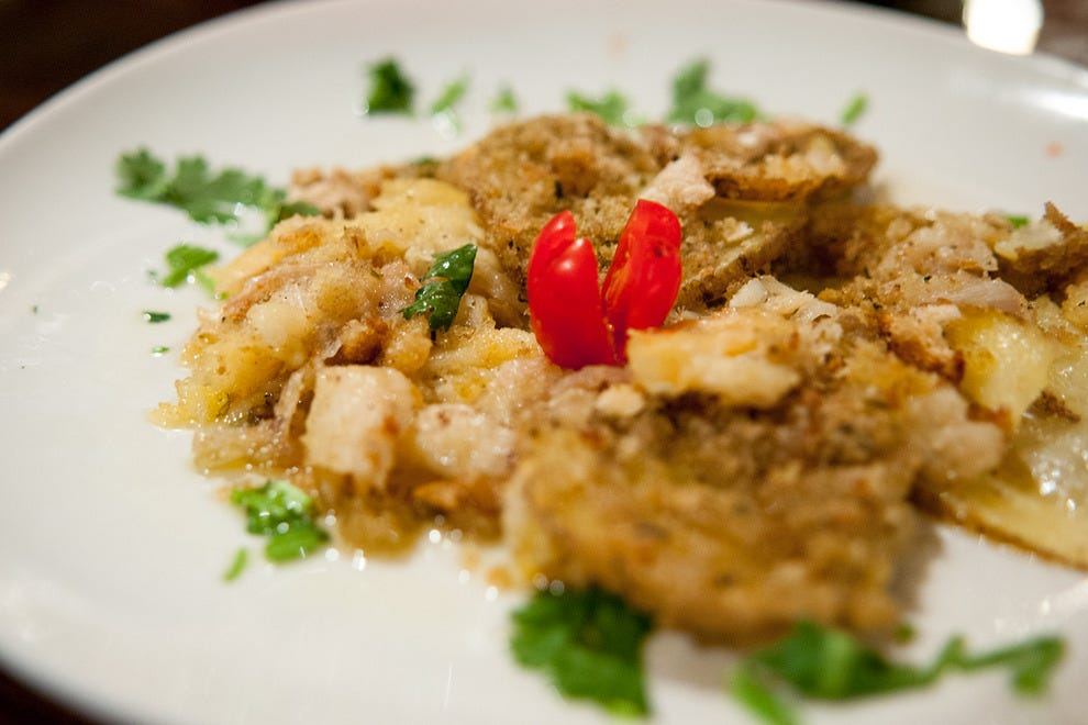 Bacalhau Madragoa, a signature dish that comprises cod and breaded potato