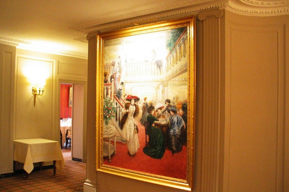 Floor to ceiling painting of Angelina at the turn of the century which graces the upstairs foyer leading into the second floor private dining rooms