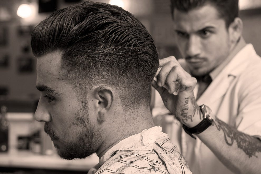 Study in concentration: the average time to cut hair at Figaro's is 45 minutes – great care is taken in achieving an authentic look