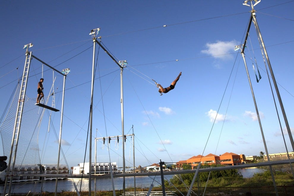 Club Med's signature activity is the flying trapeze