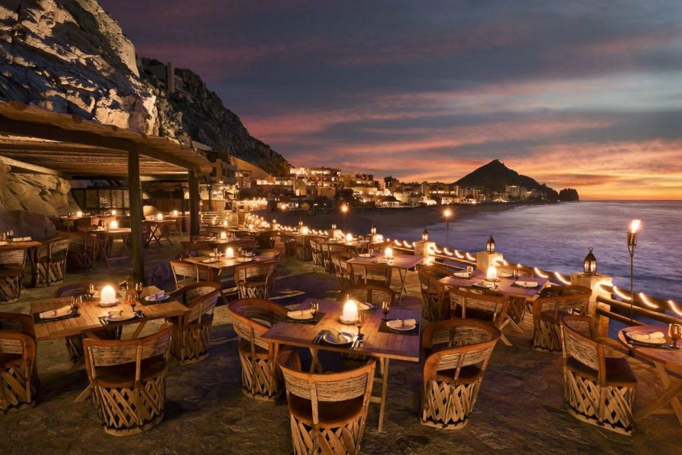 Perched on a cliff above crashing Pacific Ocean waves, The Resort at Pedregal's El Farallón Restaurant offers the ultimate wow-factor dining experience in Cabo San Lucas