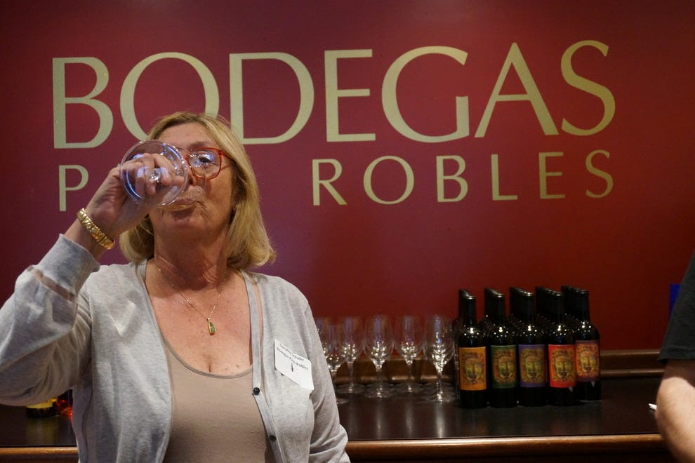 Bodegas Paso Robles winemaker Dorothy Schuler shares wine with visitors in her downtown tasting room
