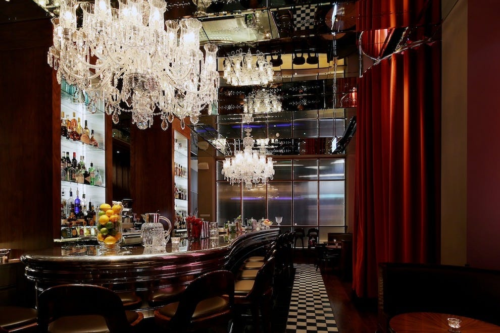 The GNH Bar features a Belle Epoque-style mirrored ceiling and crystal chandeliers