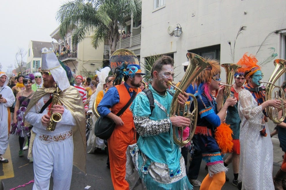 Revelers march in Societé de Saint Anne on Mardi Gras Day
