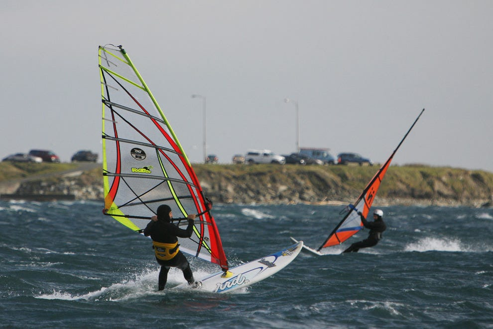 Windsurfers relish the surf at Dallas Road Beach