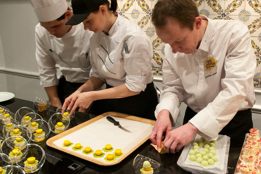 Chef pâtissier Joannic Taton (right) working studiously with his team.