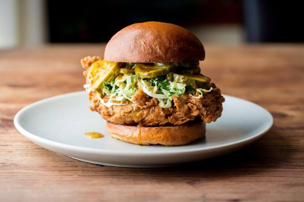 The new happy hour menu includes this incredible fried chicken sandwich with housemade pickles