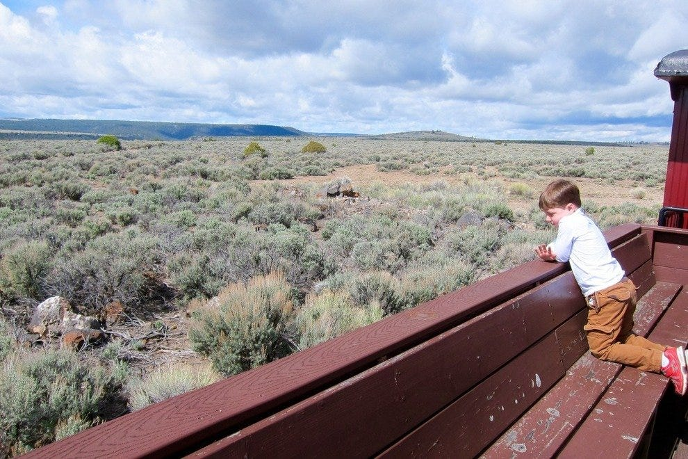 From the open gondola car, the sage-covered high desert and mesas can be seen horizon to horizon