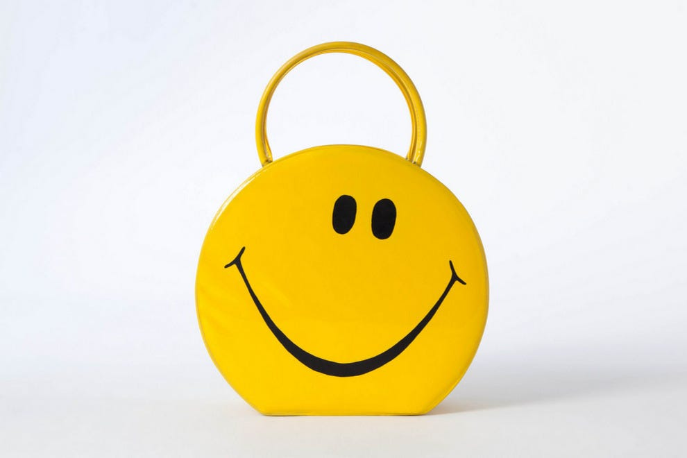 Yellow vinyl smiley face tote