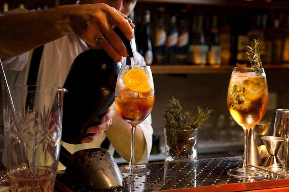 878 bartender pours a drink that could be for you