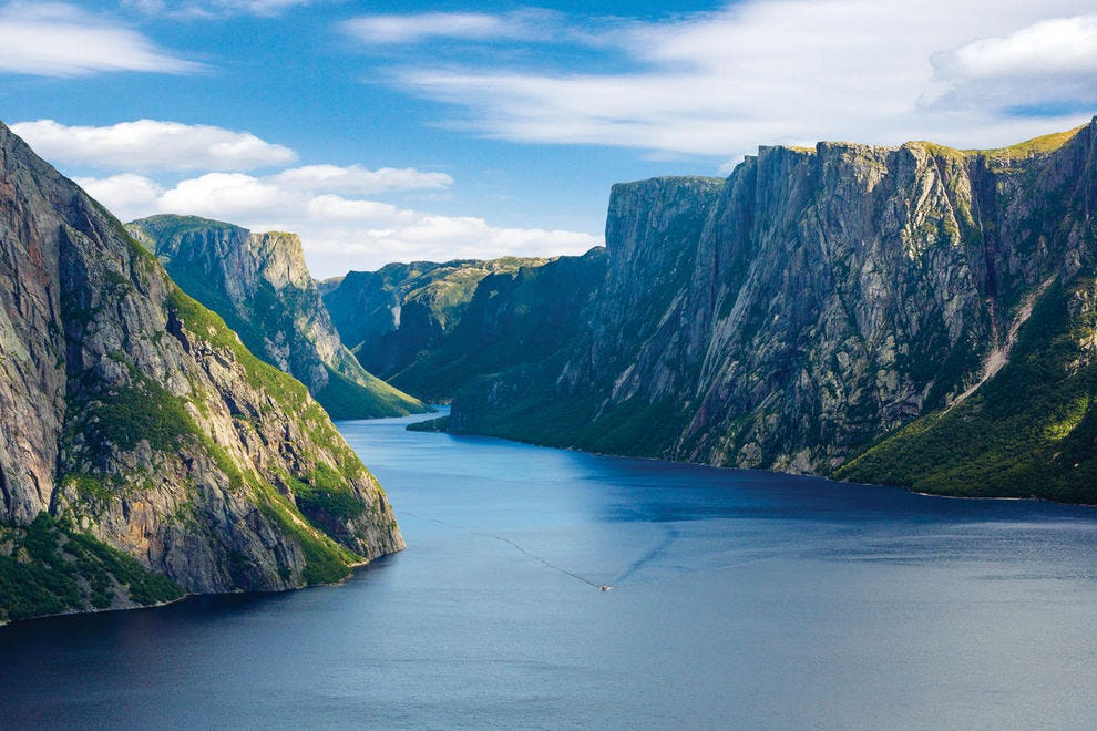 Ancient cliffs shoot up from Western Brook Pond