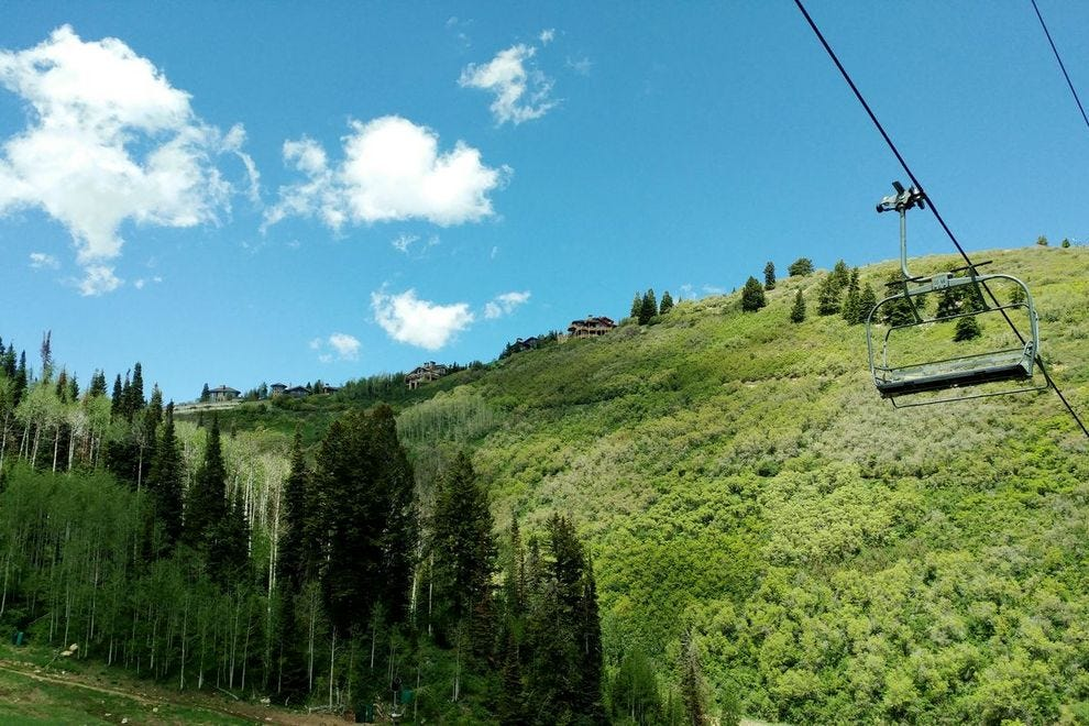 The ski lifts are eerily empty, but the trails at Deer Valley Resort, whether hiking or biking, are rife for exploration