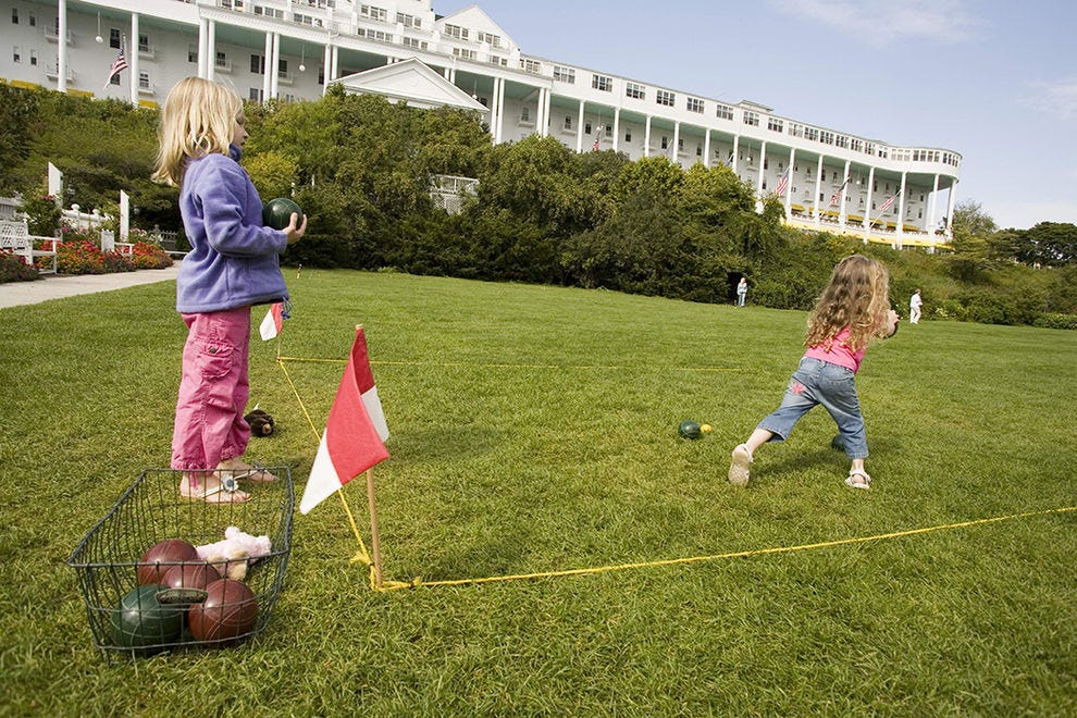 One of the simple pleasures of a stay at the Grand: Teaching your kids the finer points of lawn games