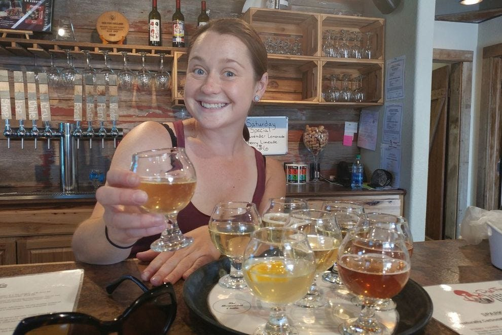 Serving happily and apple-y. Prepping a cider flight at Red Fox Cellars