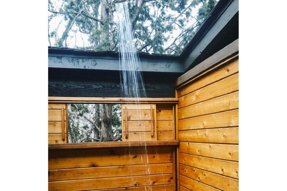 An outdoor shower with natural elements wakes up the senses and synapses