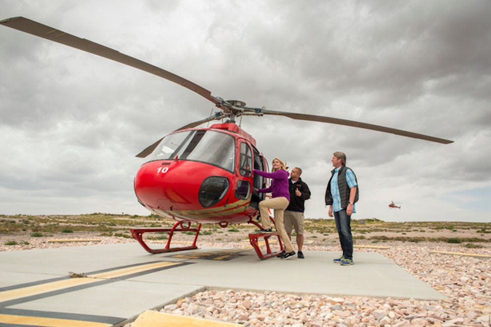 A couple waits for a Grand Canyon helicopter ride