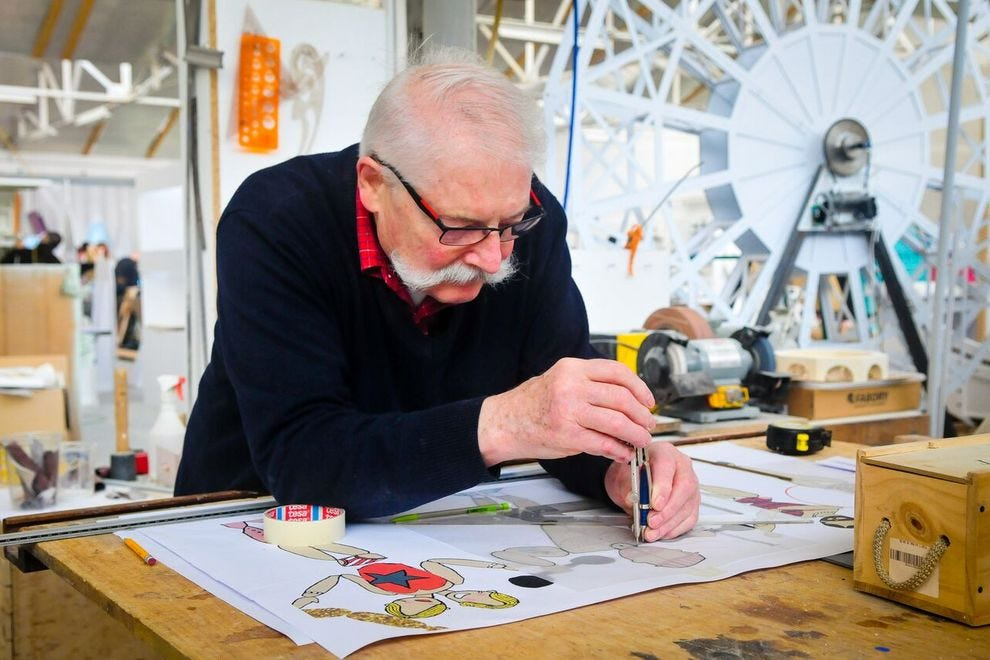 An artist works on conceptual sketches