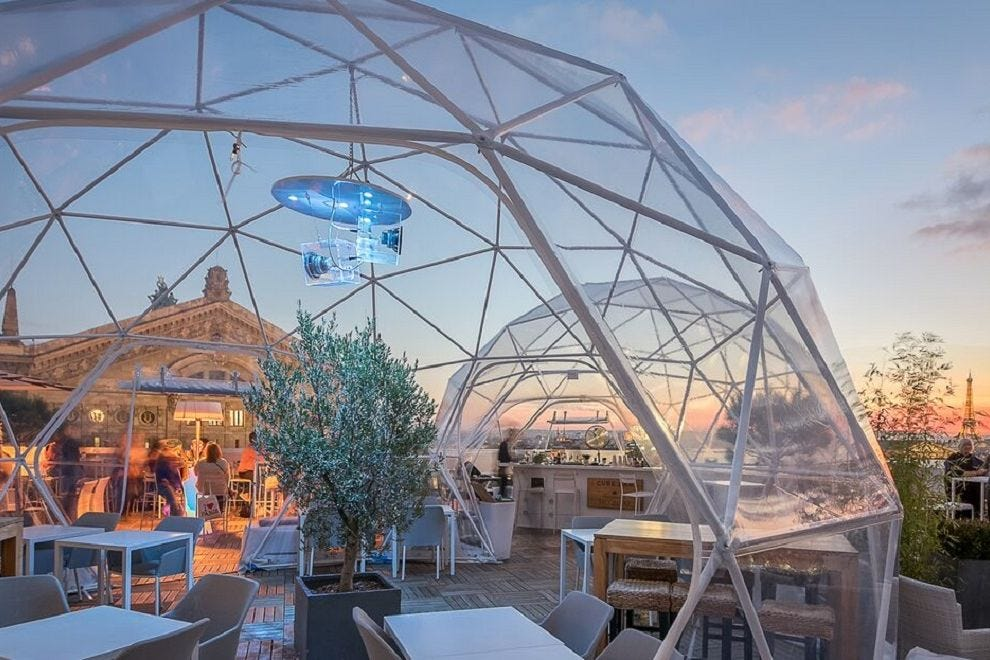 Enjoy panoramic Paris views from the festive rooftop terrace