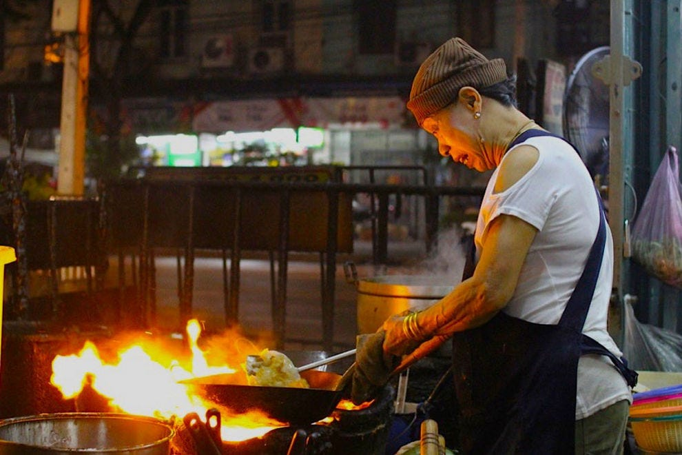 Cooking over fire at street food standout Jay Fai