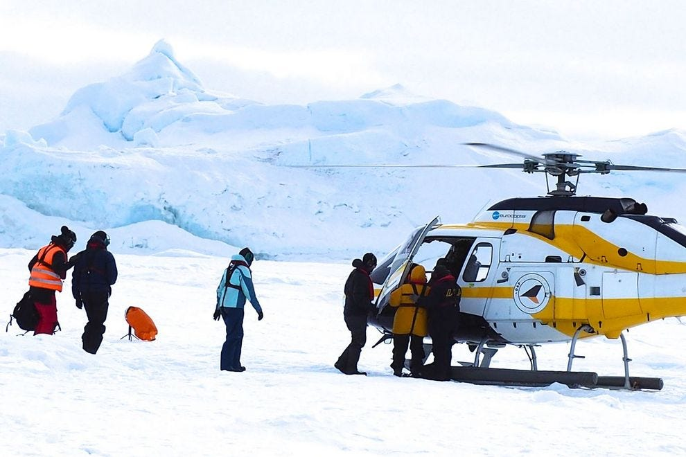 We visited the Emperor penguin colony in small groups, and the helicopters landed behind an iceberg so the colony would not be disturbed