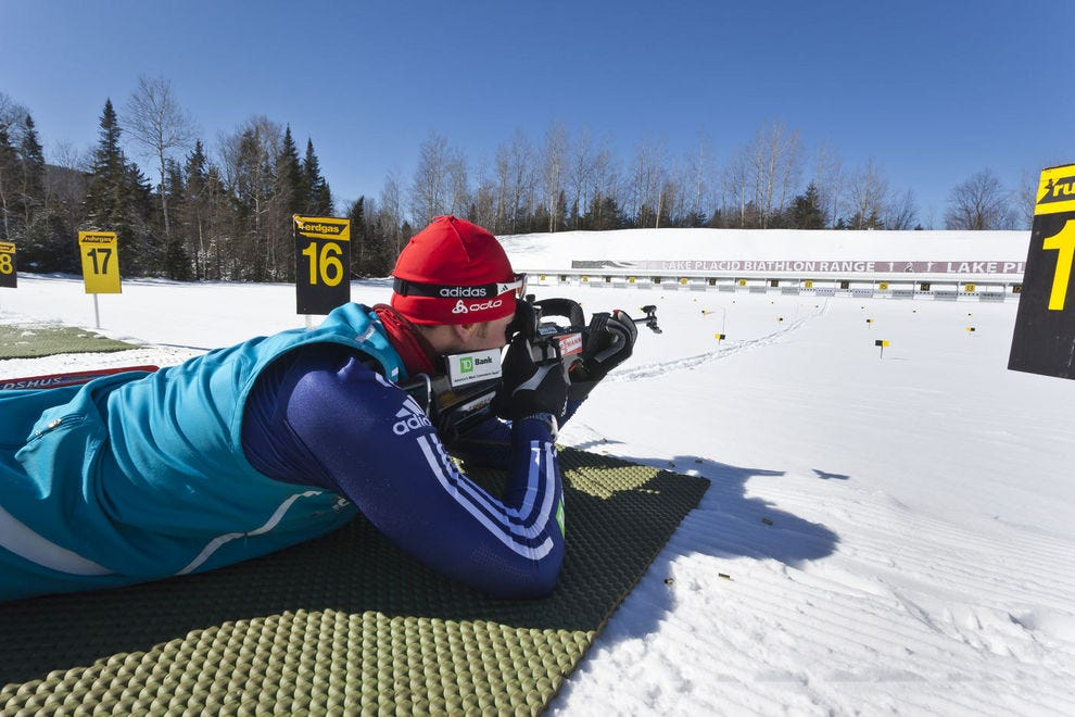 A biathlon contender takes aim