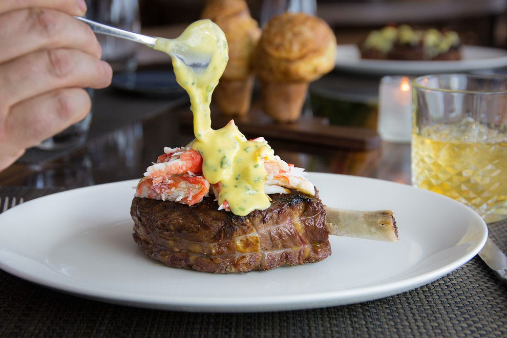 Prime bone-in rib eye with king crab Oscar add-on at Lincoln - a JW Steakhouse