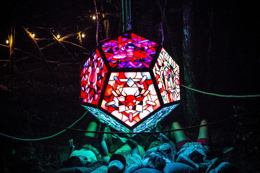 Campers chill beneath an exquisite art installation