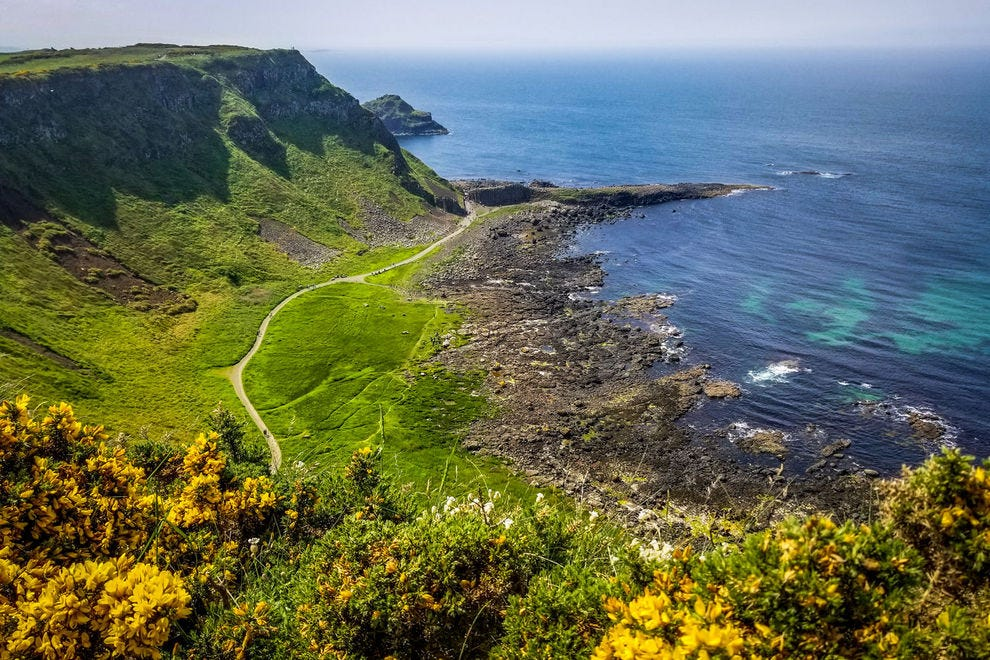 Looking down at Giant's Causeway from the clifftop trail