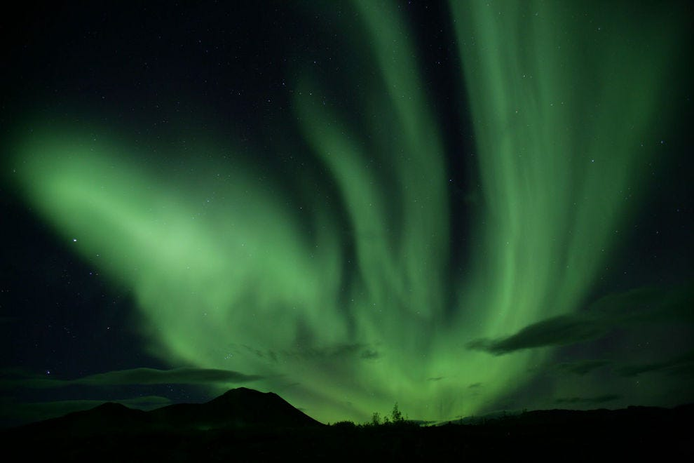 An exquisite Aurora Borealis dances along the Dempster Highway
