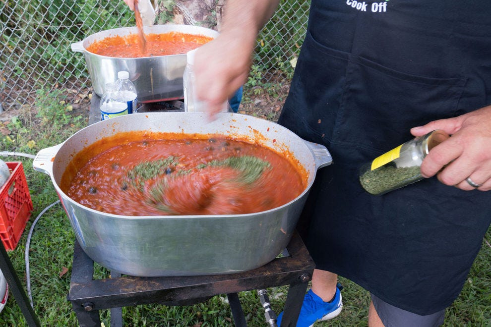 A contestant cooks up sauce piquante during the annual La Fete des Vieux Temps