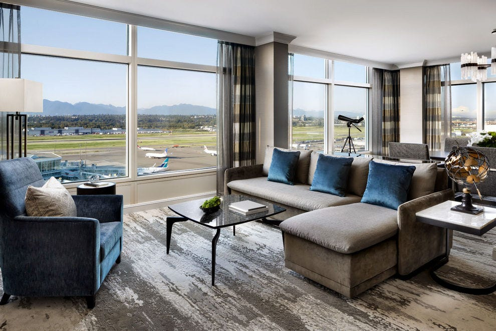 At Fairmont Vancouver Airport, the Jade Suite features incredible views of planes on the tarmac and majestic mountains in the background
