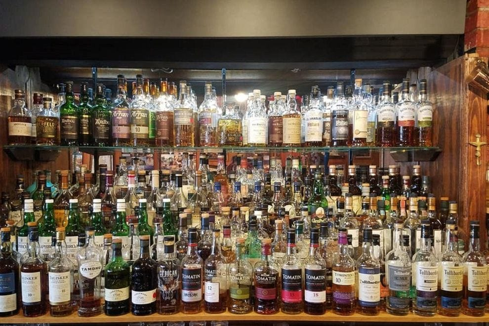 Whiskey collection at Merlin's Rest Pub